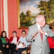 Dr. John Gump performs at the annual EKURA Christmas Party